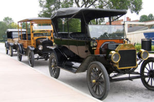 Model-T Fords lined up, the first cars to be built on an assembly line