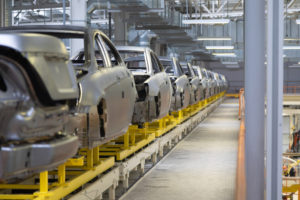 Unfinished cars on a stalled assembly line due to the microchip shortage of 2020